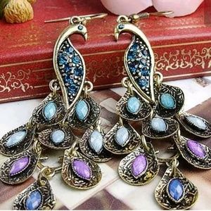 "INTERESTING 2"" light blingy peacock earrings."